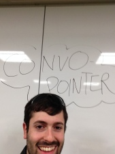 Zack standing under the (glary) Convopointer whiteboard sign, so that people could find him!